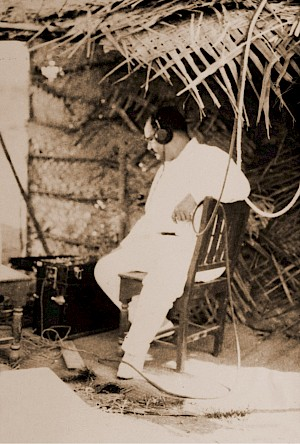 Ardeshir Irani, listening to recorded sound, on the sets of Alam Ara (1931)